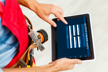 technician using Blü-Test app to check for the output of a sensor
